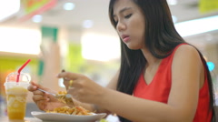 Young Asian Lady eating Pad Thai in cafe 4k UHD (3840x2160) Stock Footage