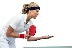 Female athlete playing table tennis on white background Stock Photos