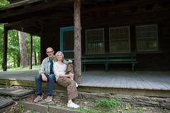 Mature couple at rural retreat - stock photo