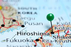 Hiroshima pinned on a map of Japan - stock photo