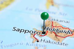 Sapporo pinned on a map of Japan - stock photo