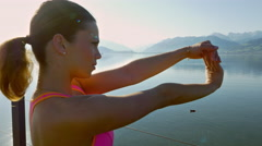 Young woman performs arm stretches Stock Footage