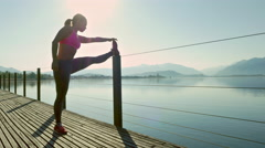 Young woman perform arm stretches Stock Footage