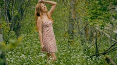 Girl in a sundress in the forest in spring Stock Footage
