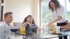 4K Happy family in the morning, chatting at the breakfast table Stock Footage