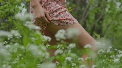 Nice legs walking on a grass the girl in the foreground Stock Footage