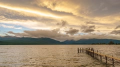 Empty Jetty By The Lake Te Anau. Sunset Motion Time Lapse Pan Right Stock Footage