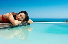Relaxing in Infinity pool - stock photo