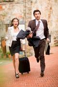 Businessman and woman in a rush - stock photo