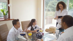 4K Happy family chatting at the breakfast table with  Stock Footage