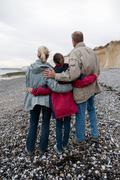 Seniors and grandchild on beach Stock Photos
