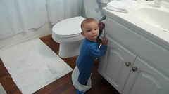 Little Toddler Playing With Toilet Paper Stock Footage