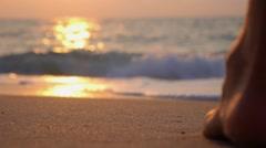 Woman Feet Walking on Beach To Sea on Sunset. Slow Motion. Stock Footage