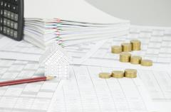 House with pencil and step gold coins on finance account Stock Photos