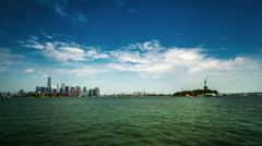 The panoramic view of the Manhattan skyline and the Statue of Liberty Stock Footage