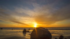 Vibrant Sunrise At Moeraki Boulders- Time lapse Zoom In Stock Footage