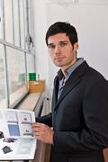 Business man reviewing a catalogue Stock Photos