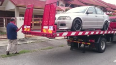 Loading Car Onto Tow Truck - stock footage