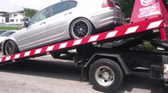 Tow Truck Offloads Car - stock footage