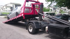Tow Truck Offloads Car Stock Footage