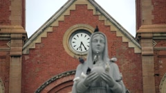 Virgin Mary statue in front of the Notre Dame Cathedral in Ho Chi Minh City Stock Footage