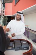 Middle eastern businessman making transaction Stock Photos