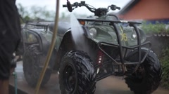 Washing ATV with high pressure pump Stock Footage