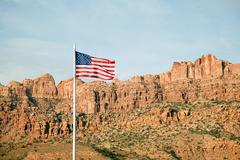 American flag and Gold Bar Rim, Moab, Utah, USA Stock Photos