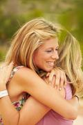 Mother and grown-up daughter embracing - stock photo