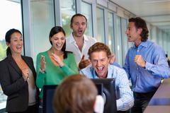 Business team closing a deal - stock photo