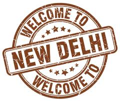 welcome to New Delhi brown round vintage stamp - stock illustration