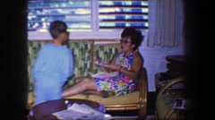 1967: Teenage girl eating little brother homemade sandwich approves of taste. Stock Footage