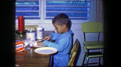 1967: Boy making sandwich Holsum white bread Kraft Marshmallow creme spread. Stock Footage