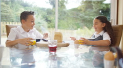4K Happy young brother & sister eating at the breakfast table Stock Footage