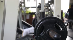 Woman Training Legs Muscle Making Push Ups with Weight in Fitness Center Stock Footage