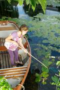 Young girl fishing with net Stock Photos