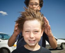 Boys hair blowing in the wind Stock Photos