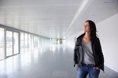 Woman in empty office space - stock photo