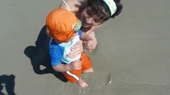 Mother With Bay Boy First Time At Beach Stock Footage