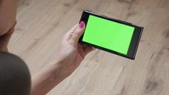 Indoor woman holding green screen display mobile smart phone 4K Arkistovideo