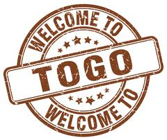Welcome to Togo brown round vintage stamp Stock Illustration