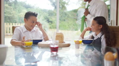 4K Happy family at breakfast time, father gives his children a kiss - stock footage