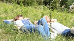 Senior couple relaxing in field on hiking day - stock footage