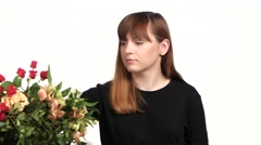 Woman takes care of flowers narcissus. White. Close up - stock footage
