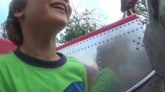 Boys Enjoying Ride At Theme Park Stock Footage