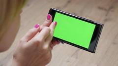 Modern woman holding green screen display mobile smart phone 4K 2160p 30fps U Arkistovideo