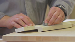 Close up of carpenter. Joiniter sanding a wood. Hand made. - stock footage