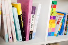 Books on bookshelf Stock Photos