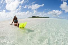 Female snorkeler on Kadhdhoo Island, Laamu Atoll, Maldives Stock Photos
