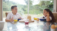 4K Happy family at breakfast time, father gives his children a kiss Stock Footage